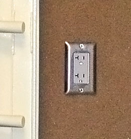 Electrical outlet for safes and shelters